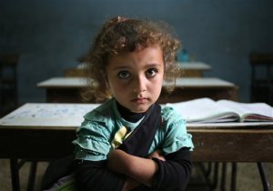 a-syrian-refugee-girl-sits-in-a-classroom-at-a-lebanese-public-school-where-only-syrian-students-attend-classes-in-the-afternoon-at-kaitaa-village-in-north-lebanon